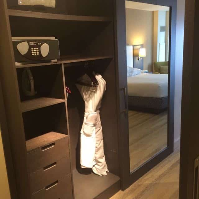 Closet with sliding mirror