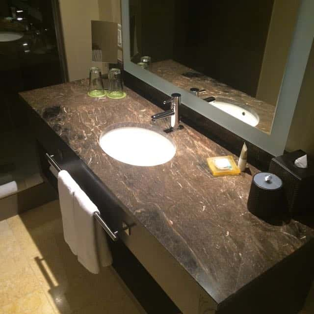 Single vanity with shower just beyond